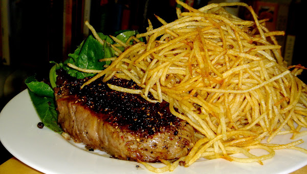 If you have a deep-fryer at home, recreating these classic steak frites is quite simple; if you don't, the process of frying the potatoes will just be slightly more involved. I've supplied a recipe for a spicy aioli, which is delicious with frites. It yields more than enough for two servings of frites and will keep for weeks in the refrigerator. // alexandracooks.com