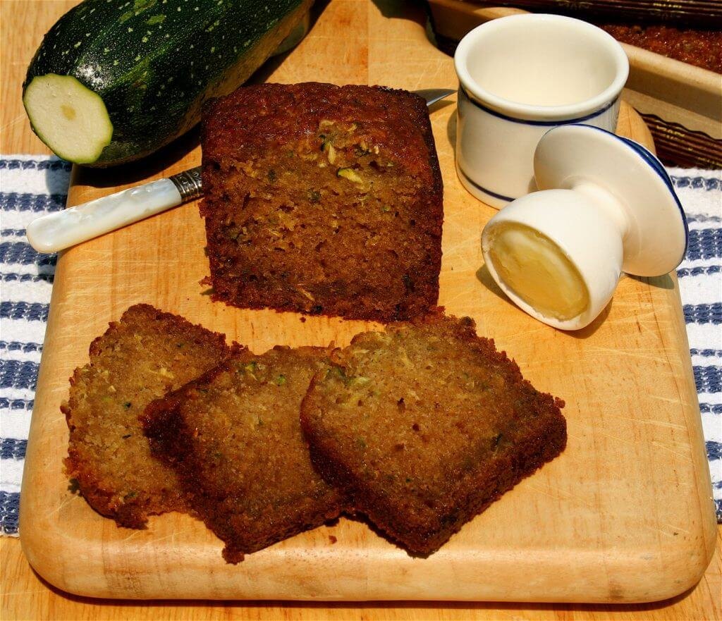 A quick bread made with brown sugar and white, eggs and oil, this super moist zucchini bread makes a wonderful addition to breakfast coffee or afternoon tea all summer long! I have been making this recipe for years, an oldie but such a goodie, a hit with adults and children alike. // alexandracooks.com