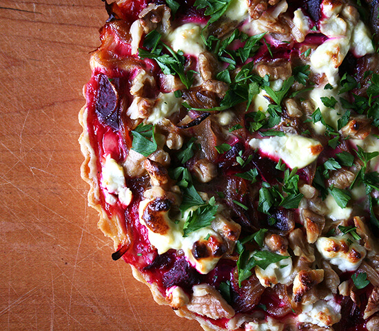 This goat cheese walnut tart is really fun. And different. And delicious. I can't promise a quick-and-easy dinner with this recipe — beets must be roasted; a tart shell must be baked — but with a little planning, assembly of this tart is quite simple. And it is so worth the effort. // alexandracooks.com