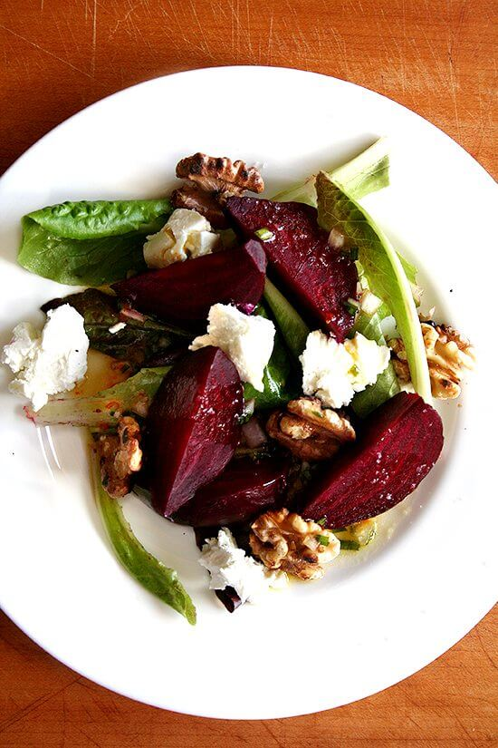 This roasted beet salad features salted roasted beets. They taste delicious. And sweet. And perfectly firm. And add a new and interesting flavor to a traditional goat cheese, beet, and walnut salad. The orange dressing spooned over all of it is also particularly nice! // alexandracooks.com