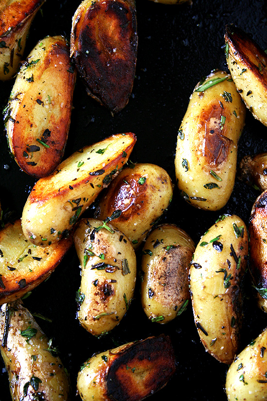 These fingerling potatoes are cooked perfectly, not the slightest bit overdone. And moreover, they are seasoned perfectly, too, not a bit too salty and subtly infused with the flavors of rosemary, thyme and garlic. It's such a treat. I think you'll like them, too. // alexandracooks.com