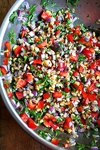 farro salad with roasted corn, diced red peppers and cilantro