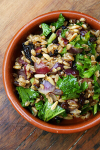 farro salad with pine nuts, currants and mustard greens