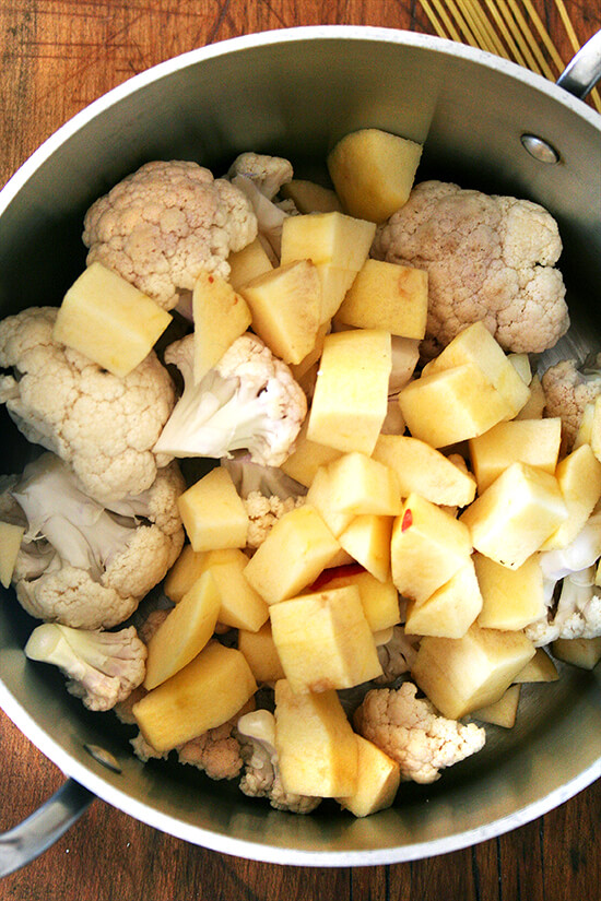 cauliflower and apples in soup pot