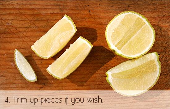 cutting a lemon for garnish, step 4