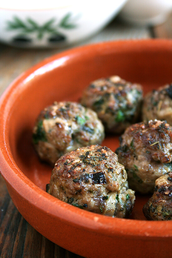 Lamb meatballs, loaded with mint and parsley, broiled, sprinkled with vinegar, and served with roasted cabbage, are perfect for Easter. // alexandracooks.com
