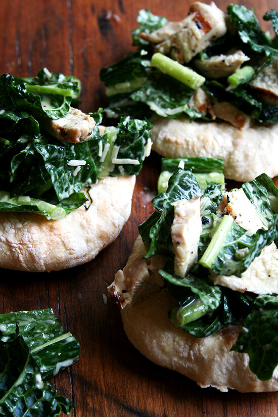 piadines topped with kale caesar and grilled chicken
