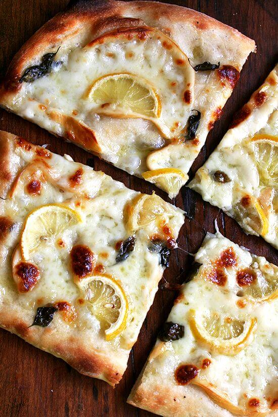 Pizza with smoked mozzarella, lemon and basil