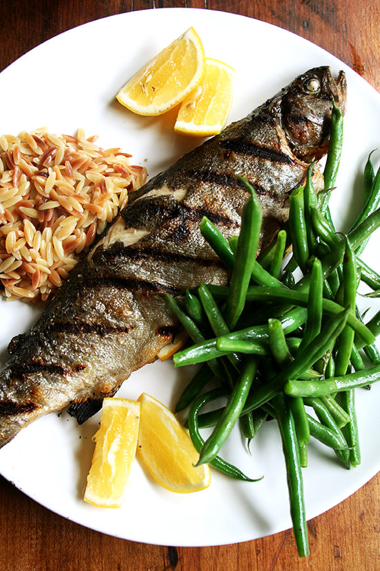 grilled whole trout dinner with green beans and brown butter orzo risotto