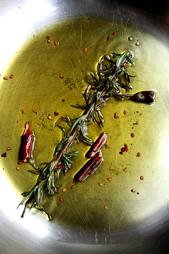 rosemary and chile de arbol sizzling in olive oil