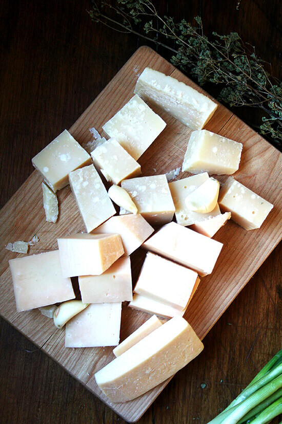 cut up Parmigiano and Asiago