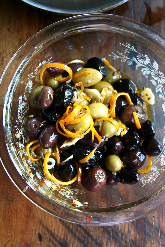 tossing olives with marinade