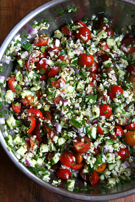 With little more than a knife, a cutting board, and a large bowl, a beautiful whole grain salad can materialize in no time. Tabbouleh, a dish my mother made for us all summer long for as long as I can remember, a dish that feels at once light, satisfying and nourishing. With some warm pita and a block of feta, dinner is served. // alexandracooks.com