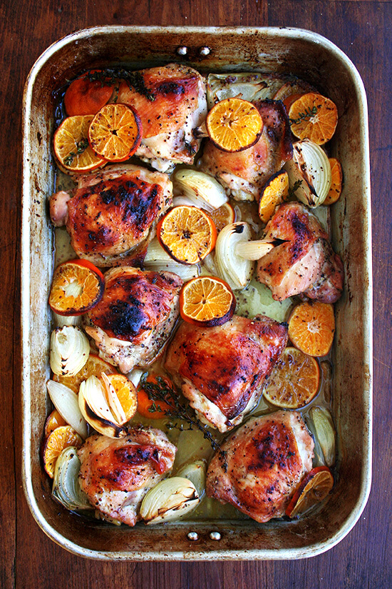 The key with this Yotam Ottolenghi roast chicken with clementines dish is to use a large roasting pan, which will allow the chicken skin to brown and crisp up beautifully. The liquid, freshly squeezed citrus juice and anise-flavored liqueur, keeps the chicken meat incredibly juicy below its crispy skin. // alexandracooks.com