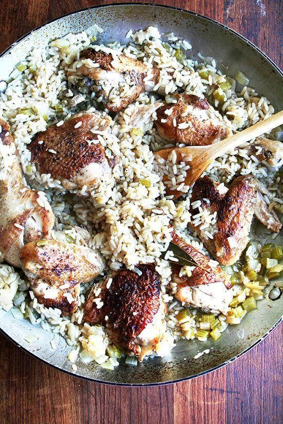 Canal House chicken and rice is miraculous foremost for its reception — we ALL gobble it up — but also for its simplicity: it's a one-pot wonder calling for nothing more than butter, one onion, a few stalks of celery, one chicken, rice and water. // alexandracooks.com