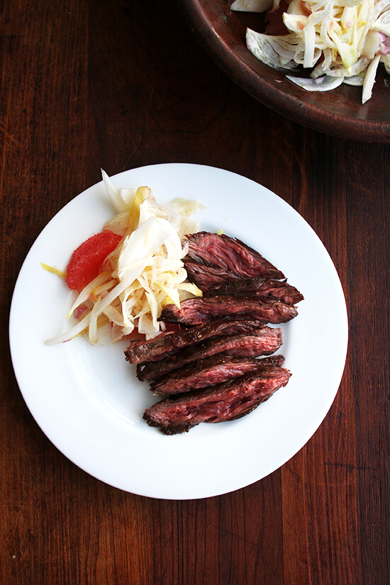 sliced steak with salad