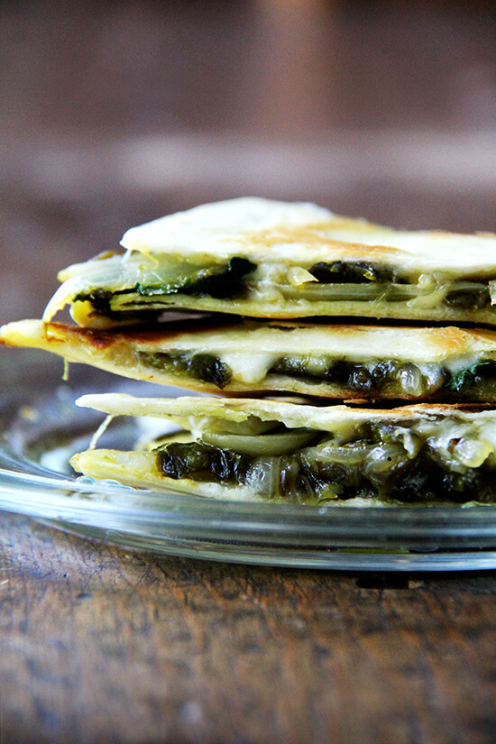 There is something so good about this simple quesadilla, about tasting each element — the smoky peppers and sweet onions, the bright cilantro, the creamy, melty Jack. As with pizza, less is more with quesadillas — a thin layer of ingredients is best. Before serving, I love stretching open the cheese-locked layers and dropping in spoonfuls of sour cream. // alexandracooks.com