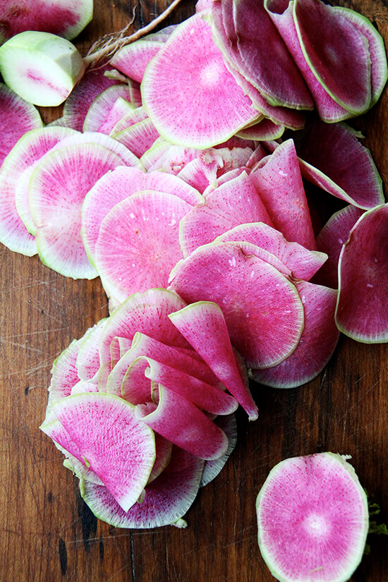 watermelon radishes, thinly sliced
