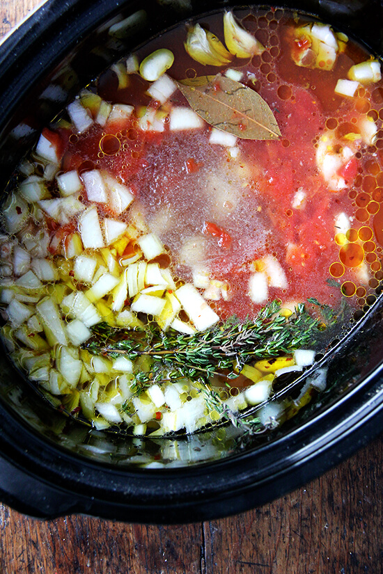adding the chicken stock and olive oil