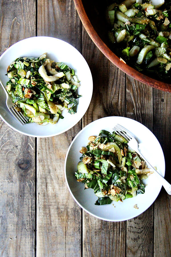 Bok choy salad is excellent as its crunchy stalks and sturdy leaves are capable of enduring a bold, salty-sweet dressing. A slightly sweet dressing, in fact, is just what slightly bitter bok choy needs. The most fun part about this recipe, however, is the sesame-almond crunch, a mix of melted sugar, toasted almonds and sesame seeds, that comes together in a flash and disappears about as quickly. // alexandracooks.com