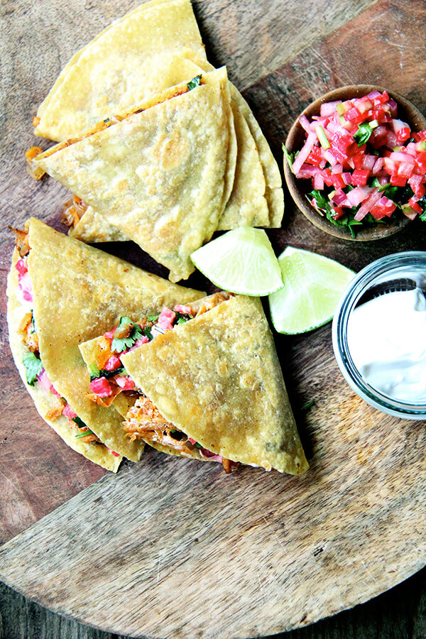 Friends, these sweet potato quesadillas have become one of my favorite things to eat. The filling, a mix of sautéed onions, grated sweet potatoes and spices (cumin, oregano, cayenne, and chili powder), comes together quickly with the help of a food processor's shredder attachment and keeps well in the fridge, making for quick preparation at the dinner hour. // alexandracooks.com