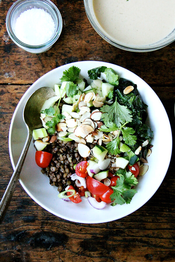 I can't seem to get enough of this bulgar bowl: a mix of bulgur and lentils, chopped cucumbers and tomatoes, toasted almonds, cilantro, and a lemon-tahini dressing. When you have some of the components prepared ahead of time, the assembly happens quickly! // alexandracooks.com
