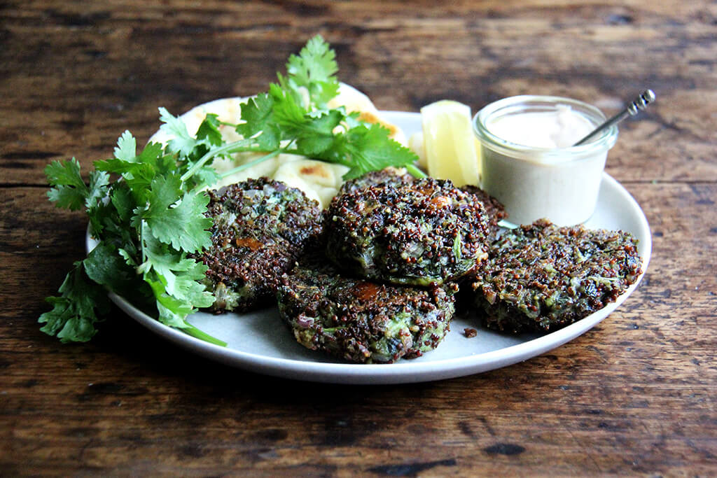 crispy quinoa cakes with mustard greens