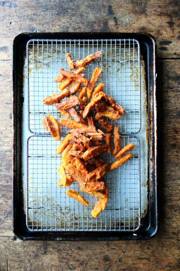 If anything deters you from making these thick-cut sweet potato fries, let it be time, not fear — of fat or the frying process — because these fries, if anything, are less greasy than roasted sweet potatoes wedges, and they are completely irresistible. // alexandracooks.com
