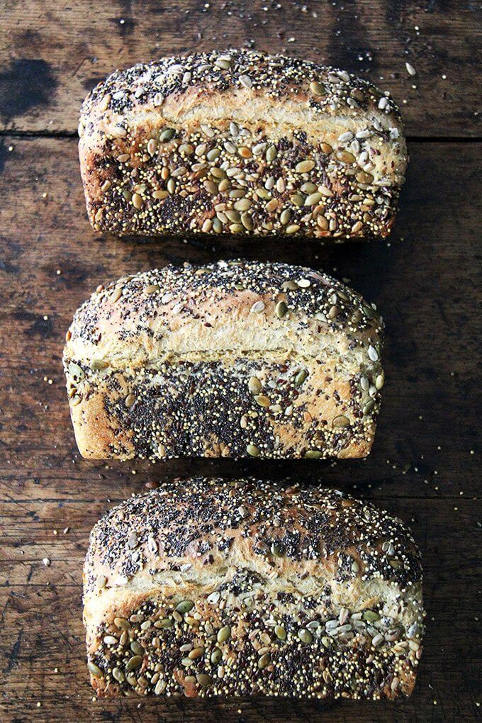 This is a basic sandwich bread, coated in seeds or not—I love the seeds; my children do not, so I make it both ways, and everyone is happy. There are three recipes - I've been keeping two loaves handy for toast and sandwiches, and slicing and freezing the third to have on hand for later in the week. // alexandracooks.com