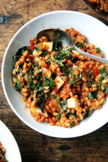 This farro risotto is a one-pot wonder made with water (as opposed to stock), and it's seasoned with thyme, smoked paprika and lemon. I love the greens and cubes of feta gently folded in at the end. // alexandracooks.com