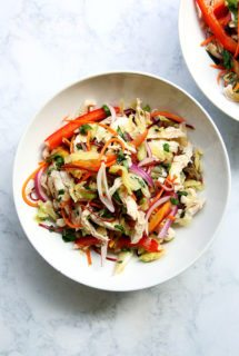 In this cabbage salad, cabbage is tossed with a simple Thai dressing—fresh lime juice, fish sauce, sugar, and Sriracha—and a ton of chopped cilantro, scallions, and vegetables. It comes together in a snap, and tastes light and summery. I've added shredded chicken to make it more of a meal, but it could work as a side salad, too, a cooling accompaniment to grilled fish or steak. // alexandracooks.com