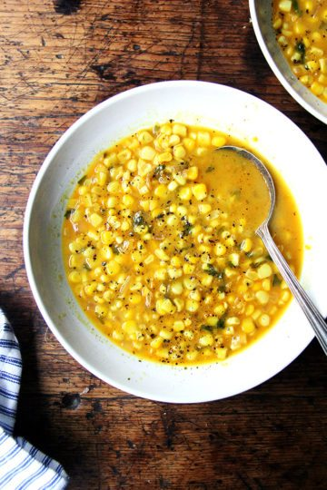 I've yet to add a single garnish to this curried coconut corn soup, finding it deeply satisfying on its own: full of texture, spiced but not spicy, naturally sweet and tart thanks to the corn and lime, with a subtle richness and creaminess lent by the coconut milk. Warm up a hunk of bread and call dinner done. // alexandracooks.com
